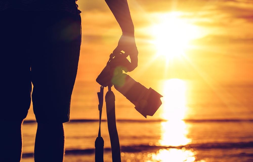 Photographer facing sunset