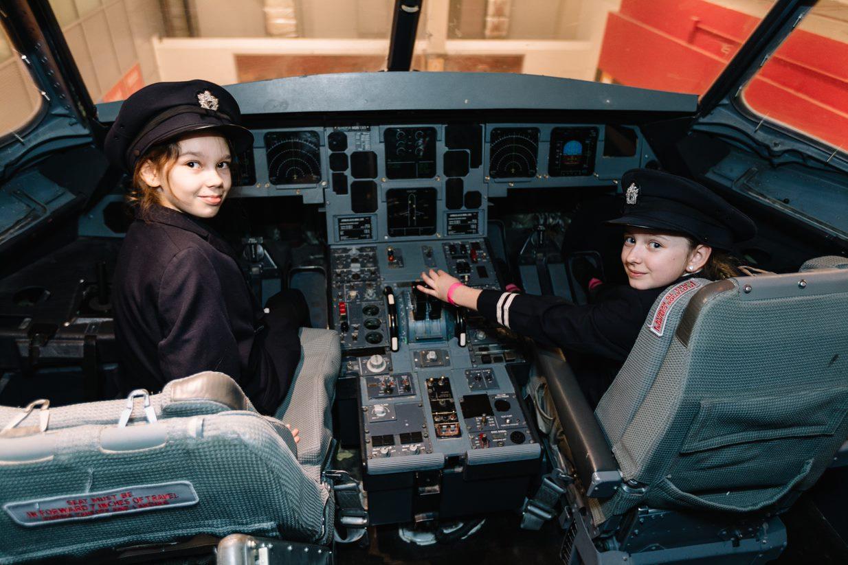 british airways kids as pilots in cockpit