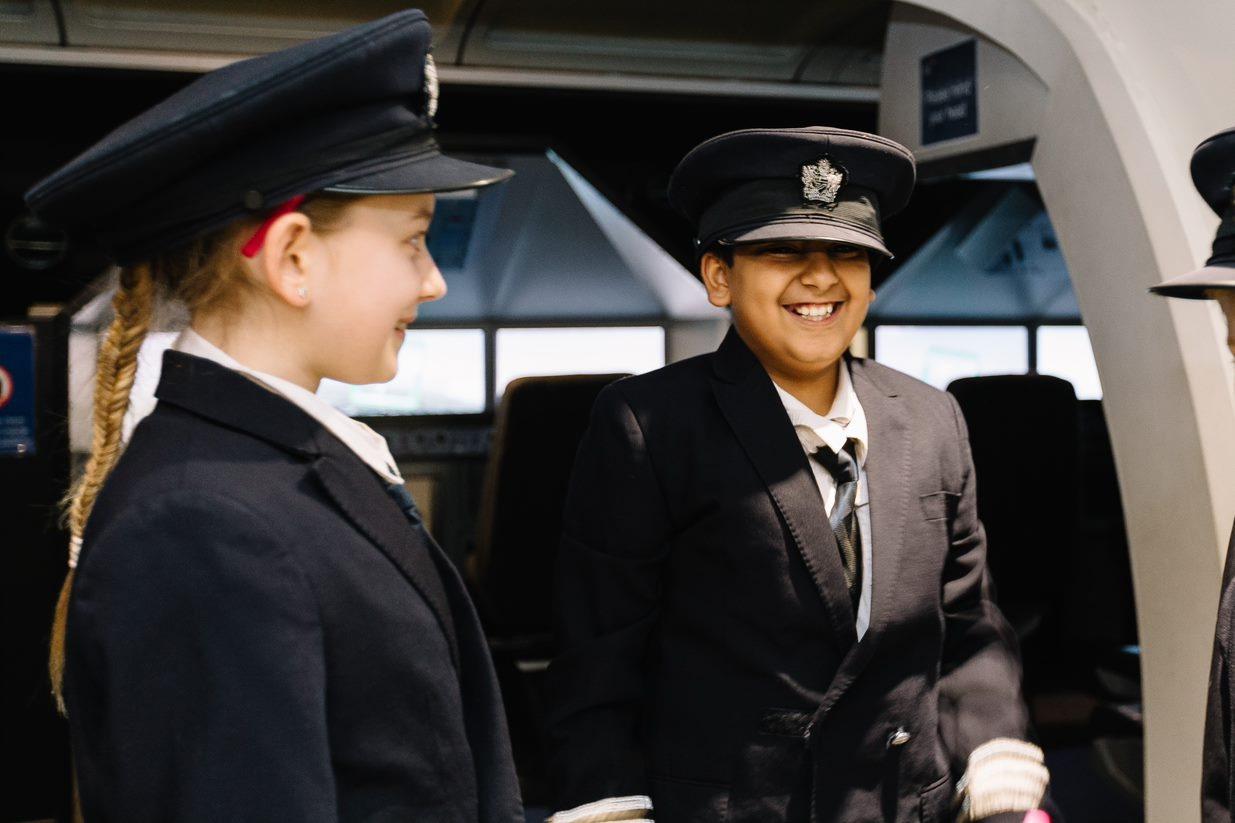 BA kids in pilot uniforms